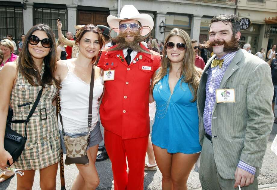 Tourists Elaine Oliveira, Zuleika Riveron and Daniele Alfonso pose with contestants Paul Roof of Charleston, S.C., and Derek Nehrbass of New Orleans. Photo: Susan Poag, Associated Press
