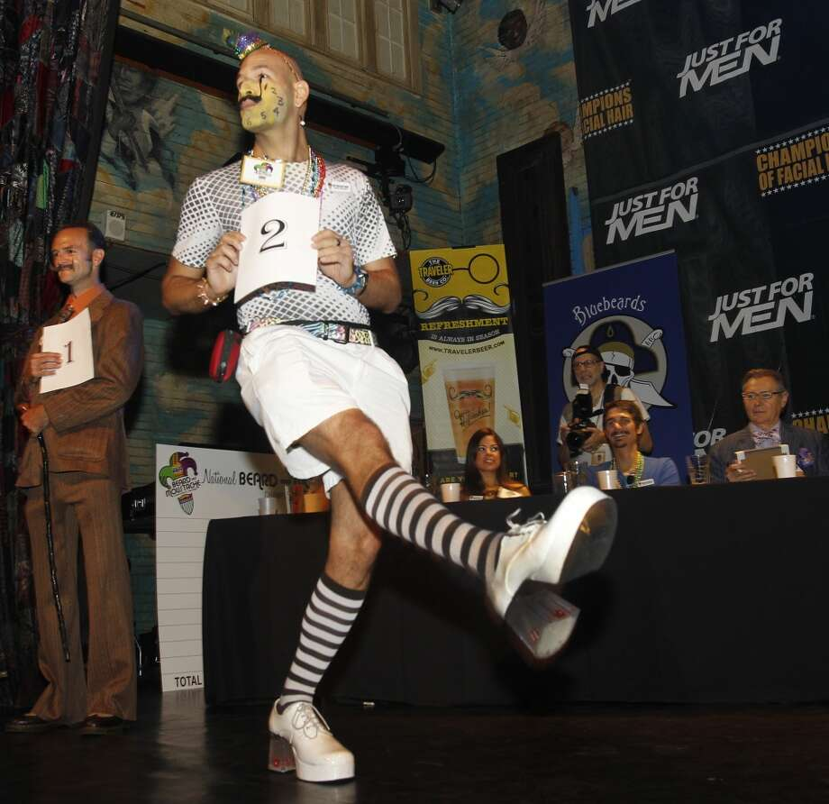 As contestant number one Ian Stetler, far left, waits his turn, Keith Haubrich of Seattle, Wash., struts his stuff in the Dali Moustache division. Photo: Susan Poag, Associated Press