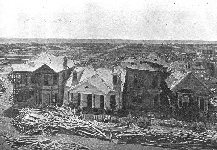 September 1900: Four houses remain standing on Sealy Street in Galveston, Texas after a surprise hurricane devastated the then prospering city. More than 6,000 people died and 10,000 were left homeless in what remains the worst natural disaster in U.S. history. The ten streets between these houses and the Gulf Coast, seen in the background, were obliterated in the storm. Photo: AP / ROSENBERG LIBRARY