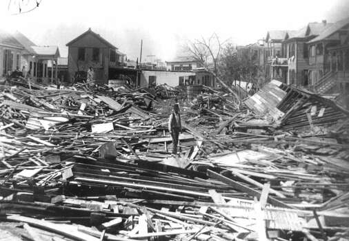 ADVANCE FOR SUNDAY, AUG. 27--FILE--A man walks through the debris in Galveston, Texas, in Sept. 1900 after a surprise hurricane devastated the then prospering city. More than 6,000 people died and 10,000 were left homeless in what remains the worst natural disaster in U.S. history. (AP Photo/Mandatory credit, Rosenberg Library)