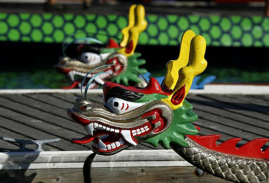 Dragon boats wait at the dock for paddlers to board during the 15th annual San Francisco International Dragon Boat Festival at Treasure Island in 2010. Most contests feature teams of 20 rowers. Photo: Paul Chinn, The Chronicle