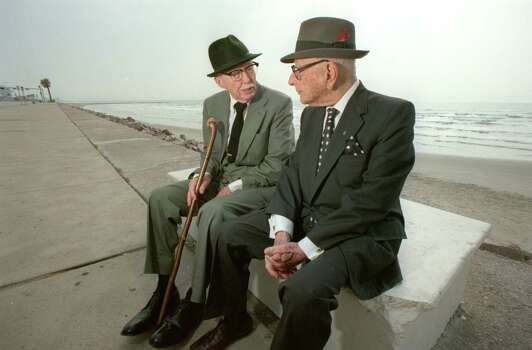 1900 Hurricane survivors John Woods Harris, left, and Adrian Levy sit on the Galveston Seawall. shot on September 5, 1990. John Woods Harris was 6 when the 1900 storm hit. He had a healthy respect for hurricanes, relatives said.  Photo: BUSTER DEAN, HOUSTON CHRONICLE / HOUSTON CHRONICLE