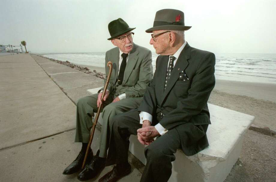 Sept. 5, 1990: 1900 Hurricane survivors John Woods Harris, left, and Adrian Levy sit on the Galveston Seawall. John Woods Harris was 6 when the 1900 storm hit. He had a healthy respect for hurricanes, relatives said.  Photo: BUSTER DEAN, HOUSTON CHRONICLE / HOUSTON CHRONICLE