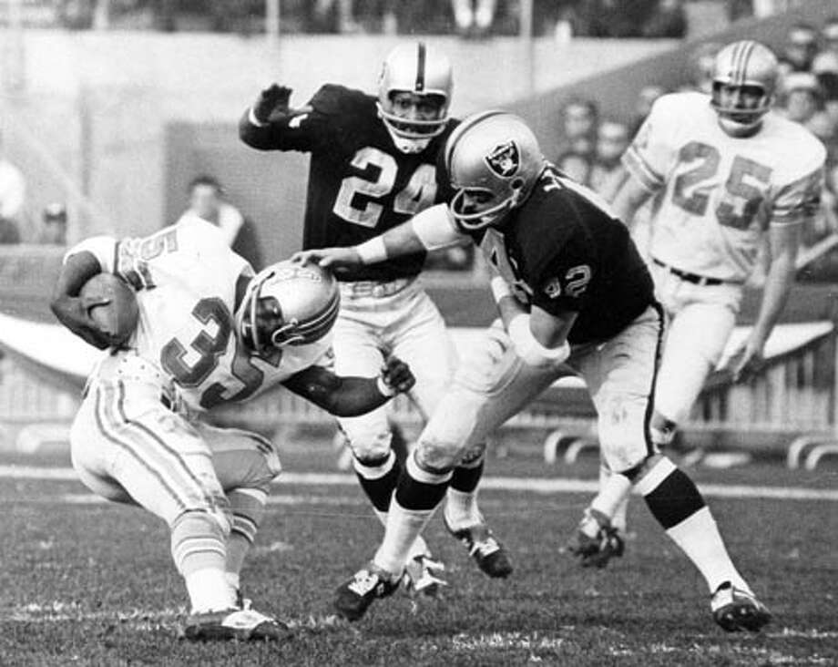Week 11, November 17, Raiders at Reliant.   Once upon a time Woody Campbell and his Oilers were drilled in Oakland for the AFL title and a spot in Super Bowl II.  Seriously.  That time was December 31, 1967.  Different scene, same cities, one different franchise, much different stakes.  The dominating result reversed.  Texans recover and run the record to 7-3. Photo: NFL, AP / LIEBB