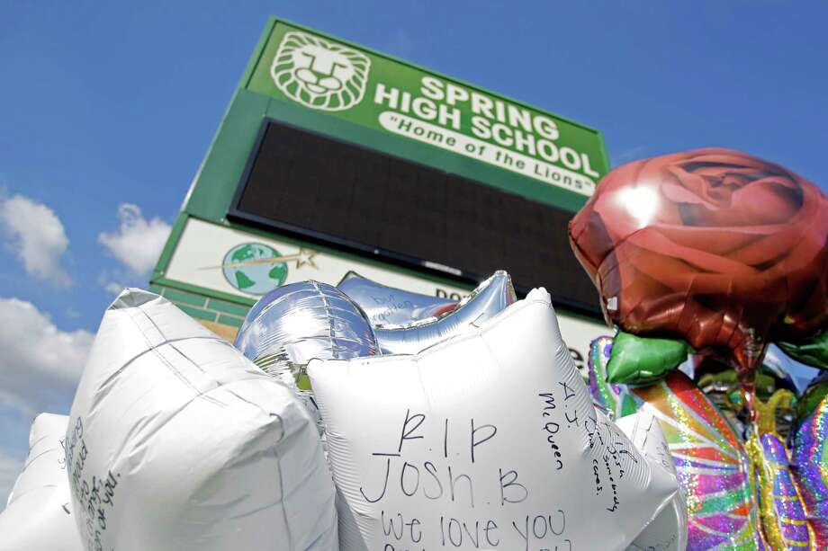A collection of balloons and other items have been placed as a memorial outside Spring High School shown Sunday, Sept. 8, 2013, in Spring. Student Joshua Broussard, 17, was fatally stabbed and three others injured at the school Wednesday, Sept. 3, 2013.  Luis Alonzo Alfaro, 17, has been charged with murder. Photo: Melissa Phillip, Houston Chronicle / © 2013  Houston Chronicle