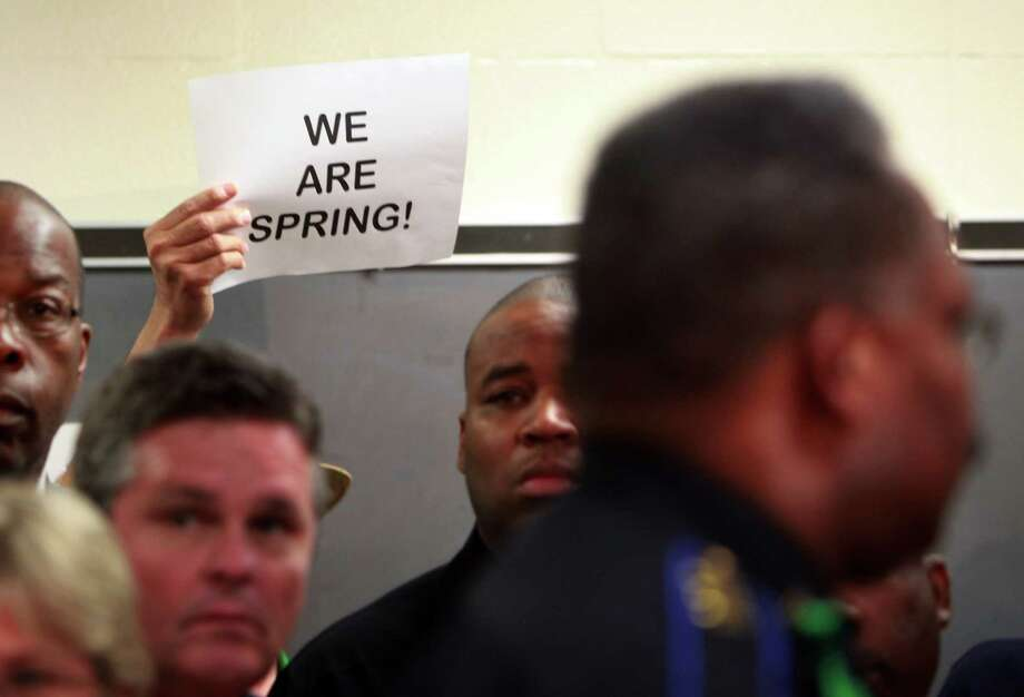 A pastor holds up a sign during the press conference at Spring High School on Friday, Sept. 6, 2013, in Spring. Photo: Mayra Beltran, Houston Chronicle / © 2013 Houston Chronicle