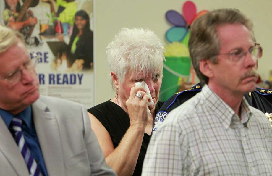 Peggy Fuss, Program Director of ARK, Adult Relating to Kids, wipes tears during a press conference at Spring High School held by SISD and Ministerial Alliance on Friday, Sept. 6, 2013, in Spring. Photo: Mayra Beltran, Houston Chronicle / © 2013 Houston Chronicle