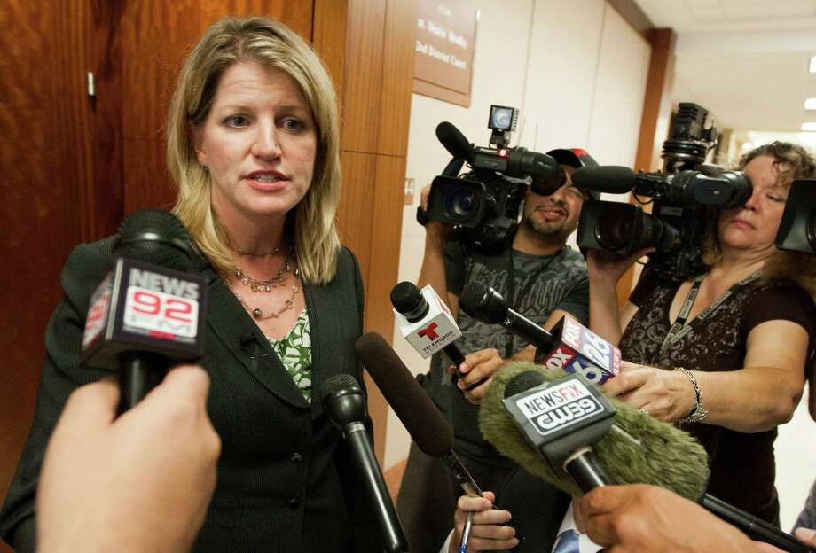 Assistant Harris County District Attorney Kelli Johnson speaks to the media after Luis Alonzo Alfaro, 17, appeared in the 262nd District Court on Friday, Sept. 6, 2013, in Houston.  Alfaro is charged with murder accused of fatally stabbing 17-year-old Joshua Broussard at Spring High School. Photo: J. Patric Schneider, For The Chronicle / © 2013 Houston Chronicle
