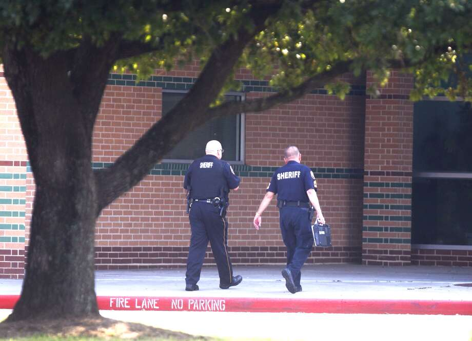 Two Harris County deputies walk into Spring High School Thursday, Sept. 5, 2013, the morning after a stabbing left one student dead and three others injured. Photo: Johnny Hanson, Houston Chronicle