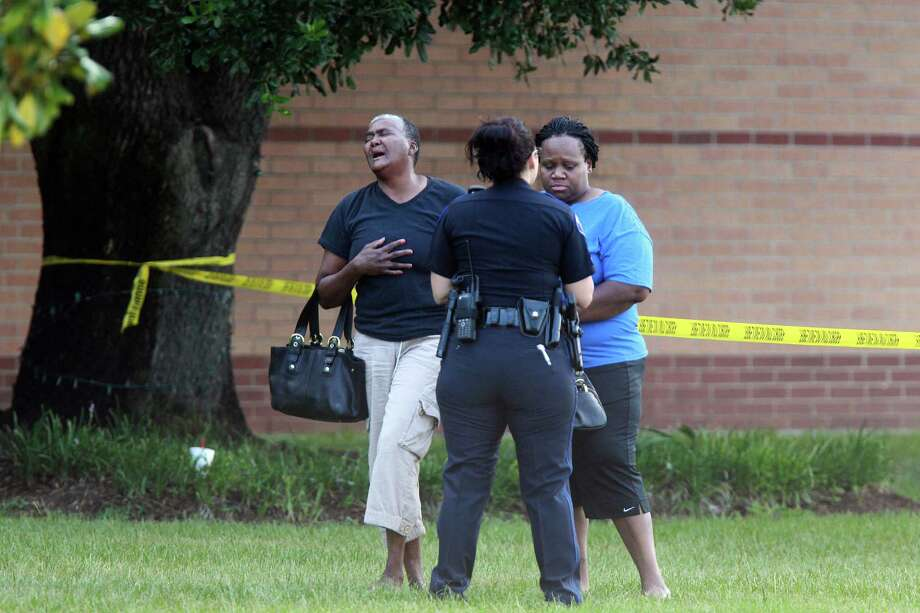 Grace Johnson weeps as she approaches Spring High School where her grandson lost his life due to an altercation on Wednesday, Sept. 4, 2013, in Spring. Harris County Sheriff's Office is investigating. Photo: Mayra Beltran, Houston Chronicle / © 2013 Houston Chronicle