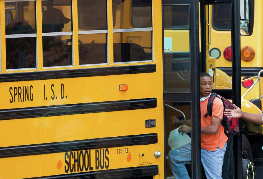 Students leave school after they were released to go home  following following a stabbing incident the school Wednesday, Sept. 4, 2013, in Spring. A student was stabbed to death and three others are injured after a fight at suburban school. Photo: Brett Coomer, Houston Chronicle / © 2013 Houston Chronicle