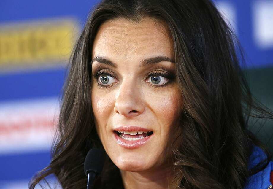 "Russian gold medalist Yelena Isinbayeva may lose her role as an Olympic ambassador for speaking in defense of Russia's law against gay ""propaganda."" Photo: Alexander Zemlianichenko, Associated Press"