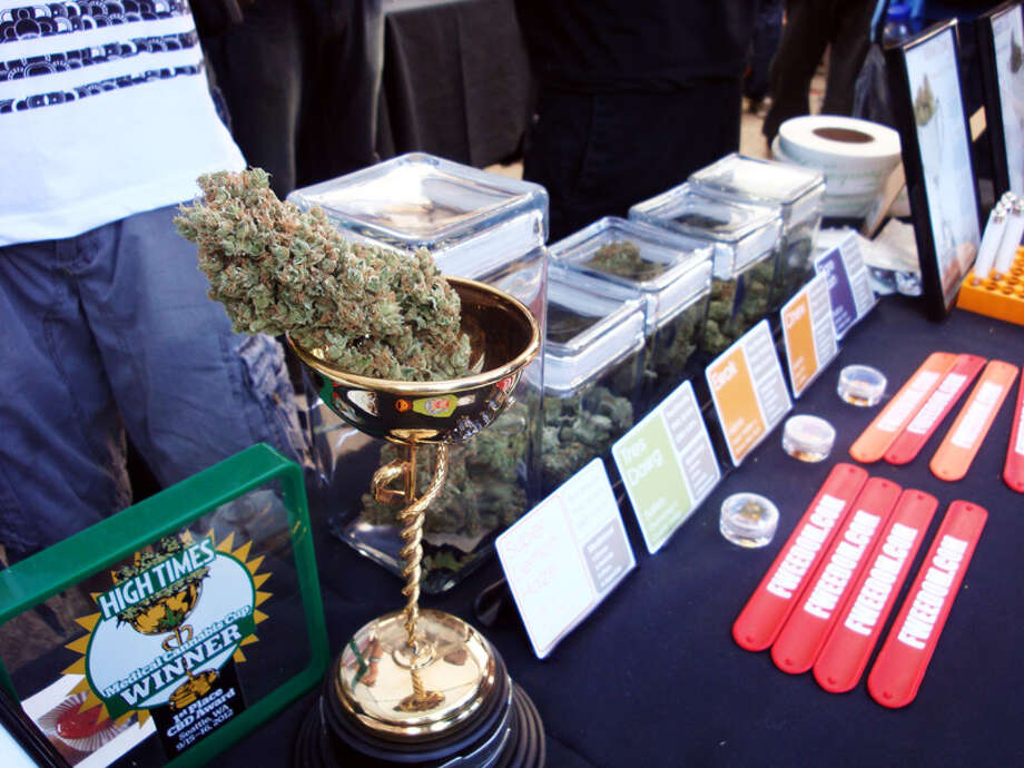 A Seattle medical cannabis dispensary shows off its previous cannabis cup.
