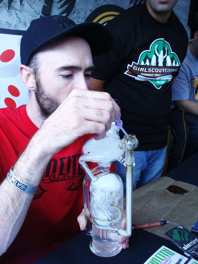 This experienced oil man tests a hash oil pipe crafted by a passing pothead.