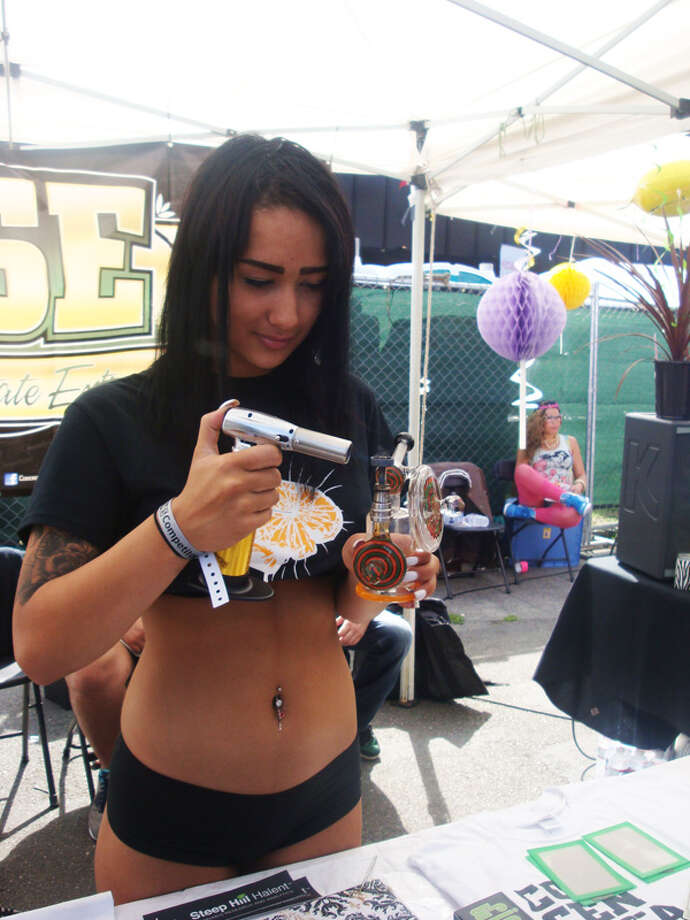 "This sparsely-dressed ""dab girl"" torches pot paraphernalia for passers by"