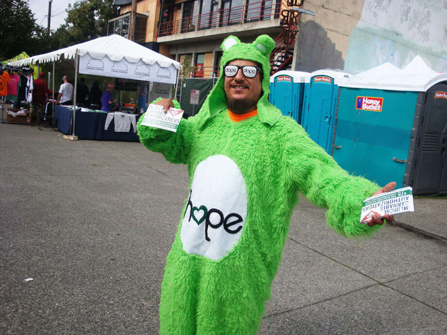 Believe it or not, this costumed man is hawking medical cannabis doctors.