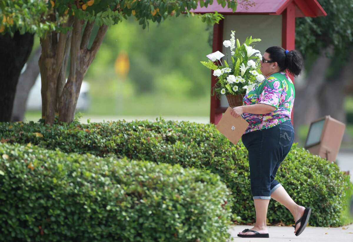 Flower arrangements arrive to Spring Baptist Church for the memorial service of Joshua Broussard on Monday, Sept. 9, 2013, in Spring.