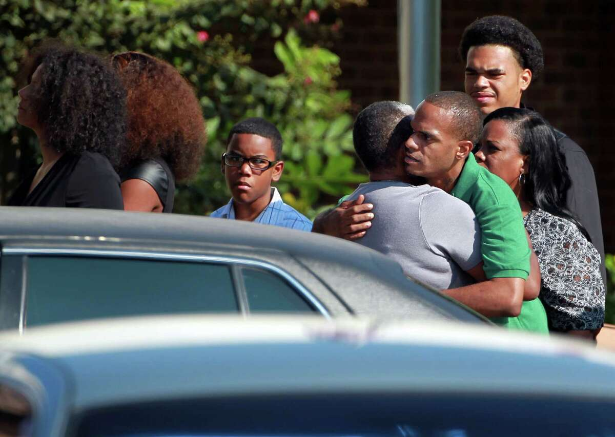 Jason Broussard, father of Joshua Broussard, embraces Grace Johnson, grandmother of victim, as family arrives to Spring Baptist Church for the memorial service of Joshua Broussard on Monday, Sept. 9, 2013, in Spring.
