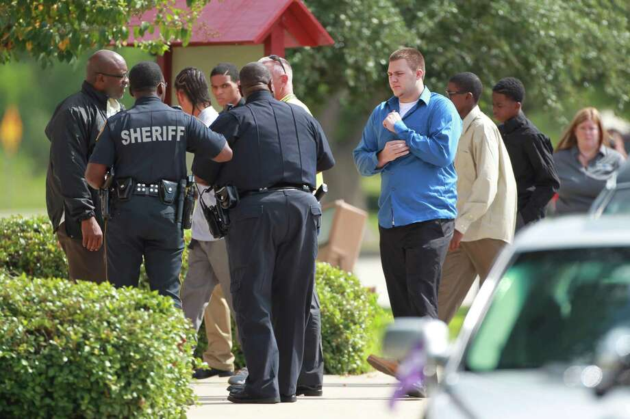 Sherriff's and SISD Police guard the exterior Spring Baptist Church as family and friends arrive for the memorial service of Joshua Broussard on Monday, Sept. 9, 2013, in Spring. Photo: Mayra Beltran, Houston Chronicle / © 2013 Houston Chronicle