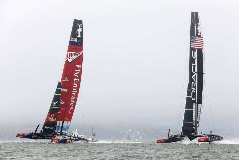 Oracle Team USA (right) and Emirates Team New Zealand race for the start line during Race 4 of the America's Cup Finals on Sunday, September 8, 2013 in San Francisco, Calif. (Beck Diefenbach/Special to the Chronicle) Photo: Beck Diefenbach, Special To The Chronicle