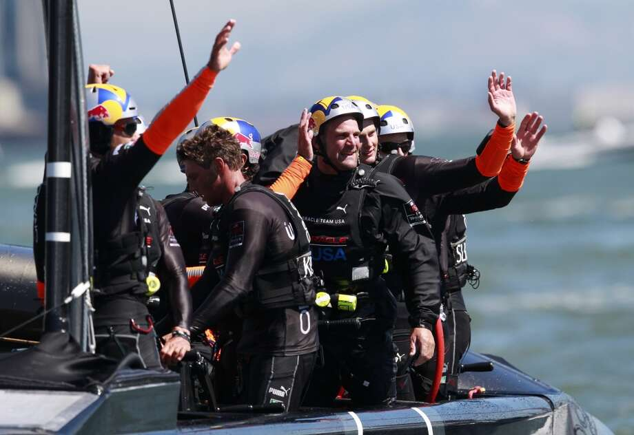 Oracle Team USA sailors wave to spectators after defeating Emirates Team New Zealand in Race 4 of the America's Cup Finals on Sunday, September 8, 2013 in San Francisco, Calif. (Beck Diefenbach/Special to the Chronicle) Photo: Beck Diefenbach, Special To The Chronicle