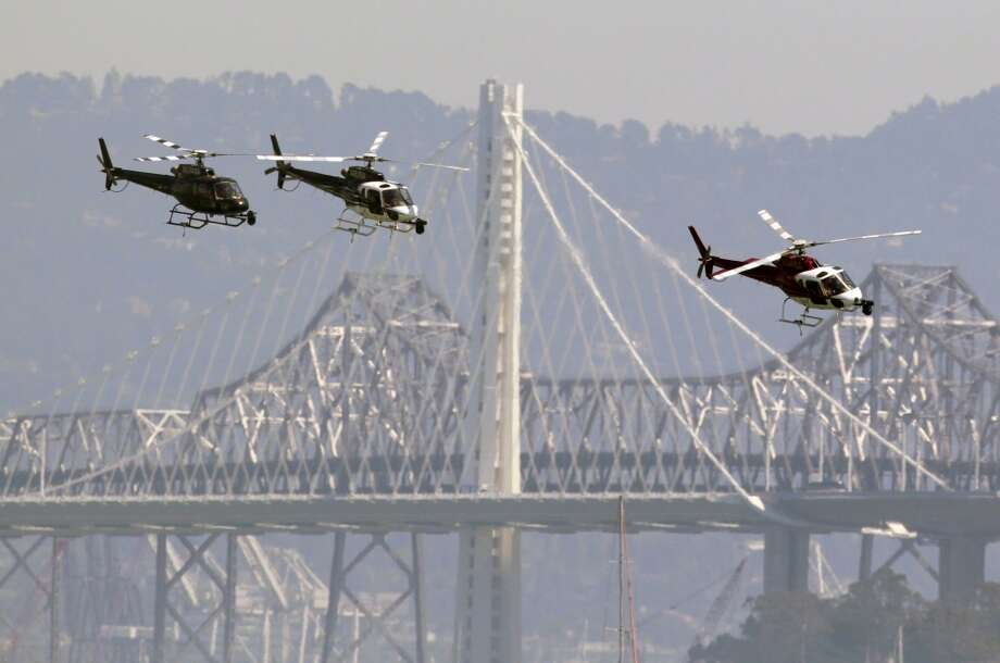 Media helicopters arrive to cover Race 3 of the America's Cup Finals between Oracle Team USA and Emirates Team New Zealand on Sunday, September 8, 2013 in San Francisco, Calif. (Beck Diefenbach/Special to the Chronicle) Photo: Beck Diefenbach, Special To The Chronicle