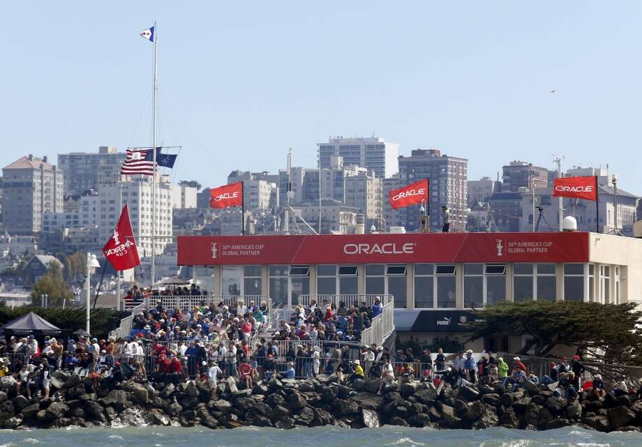 Spectators watch from the shores of the Golden Gate Yacht Club during Race 4 of the America's Cup Finals on Sunday, September 8, 2013 in San Francisco, Calif. (Beck Diefenbach/Special to the Chronicle) Photo: Beck Diefenbach, Special To The Chronicle