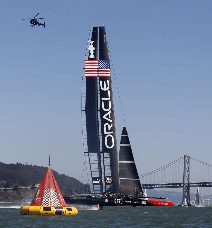 Oracle Team USA crosses the finish line to defeat Emirates Team New Zealand in Race 4 of the America's Cup Finals on Sunday, September 8, 2013 in San Francisco, Calif. (Beck Diefenbach/Special to the Chronicle) Photo: Beck Diefenbach, Special To The Chronicle