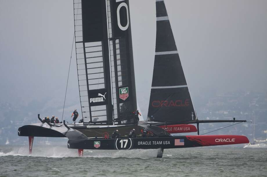 Oracle Team USA crew dashes from side to side as they round the first mark on their way to their first victory in the 43rd America's Cup. (Frank Quirarte/Special to the Chronicle) Photo: Frank Quirarte, Special To The Chronicle