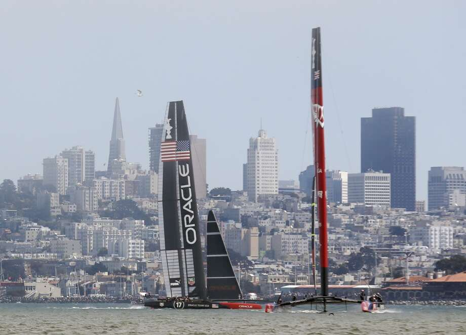 Emirates Team New Zealand (right) leads Oracle Team USA during the second leg of Race 3 of the America's Cup Finals on Sunday, September 8, 2013 in San Francisco, Calif. (Beck Diefenbach/Special to the Chronicle) Photo: Beck Diefenbach, Special To The Chronicle