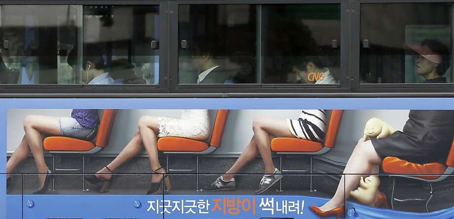 Stop the bus!What are those things crawling over that lady's legs?! (Ad on the side of bus in downtown Seoul.) Photo: Lee Jin-man, Associated Press