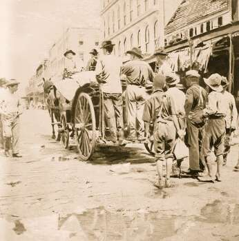 Men ride behind a horse drawn cart as they gather up the dead from Galveston streets, after the devastating hurricane, Galveston, TX, 1900. (Photo by Buyenlarge/Getty Images) Photo: Buyenlarge, Getty Images