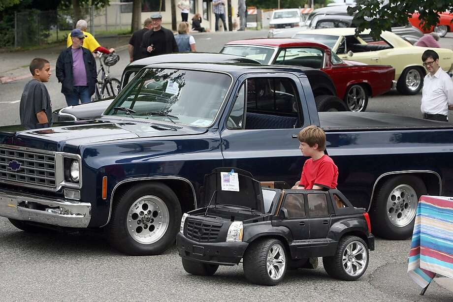 One of these days ... Twelve-year-old Alex Pettygrove looks wistfully at the adult-sized competition after parking his entry in the 