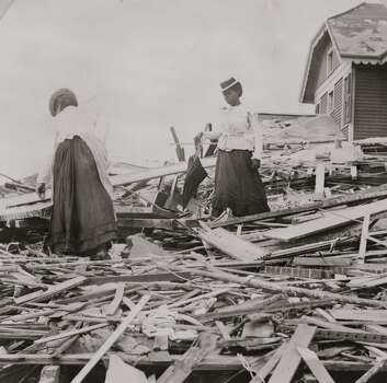 UNITED STATES - CIRCA 1900:  Two African American women search through rubble following a violent hurricane which devastated most of Galveston and took more than 5,000 lives.  (Photo by Buyenlarge/Getty Images) Photo: Buyenlarge, Getty Images