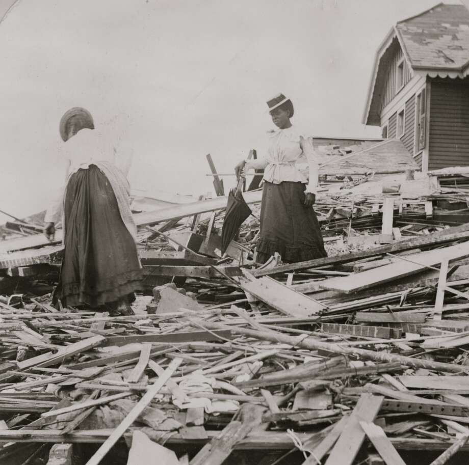 September 1900:  Two African American women search through rubble following a violent hurricane which devastated most of Galveston and took more than 5,000 lives. Photo: Buyenlarge, Getty Images