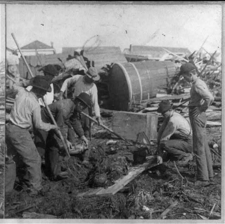 September 1900: Workers try to clean up debris in the aftermath of the 1900 Galveston hurricane. Photo: U.S. Library Of Congress