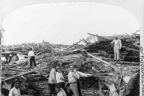 A disaster relief crew sorts through the hurricane's wreckage in the aftermath of the 1900 Galveston hurricane.
