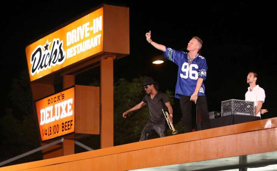 Macklemore and Ryan Lewis perform for a video shoot on Wednesday on the roof of the Capitol Hill Dick's Drive-In. Photo: JOSHUA TRUJILLO/SEATTLEPI.COM