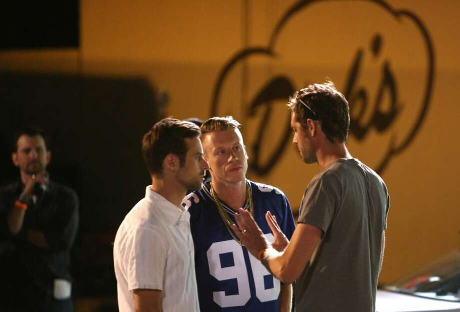 Macklemore and Ryan Lewis get some coaching during a video shoot on Wednesday, July 24, 2013 at the Capitol Hill Dick's Drive-In. Photo: JOSHUA TRUJILLO/SEATTLEPI.COM