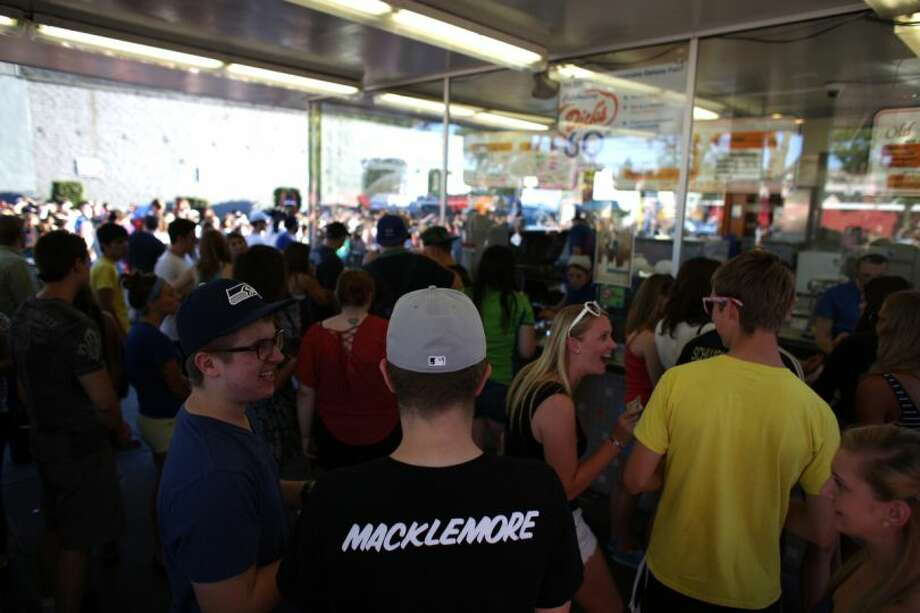 Customers wait in line on Wednesday at the Capitol Hill Dick's Drive-In. Photo: JOSHUA TRUJILLO/SEATTLEPI.COM