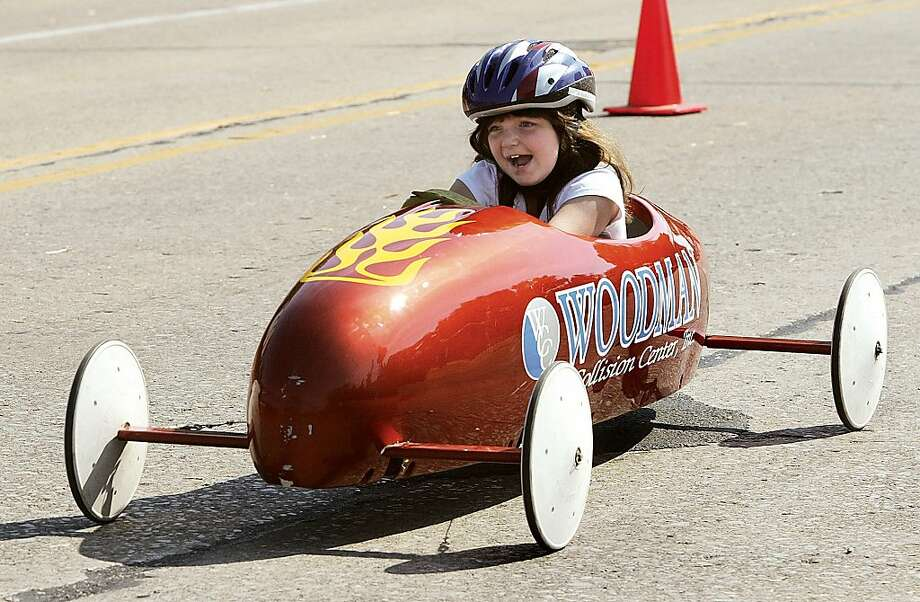 April Siglar, of East Alton, Ill., races in the 20th annual Soapbox Festival in East Alton, Ill., Saturday, Sept. 7, 2013.  (AP Photo/The Telegraph,Margie M. Barnes)  THE NEWS-DEMOCRAT AND THE POST-DISPATCH OUT Photo: Margie M. Barnes, Associated Press