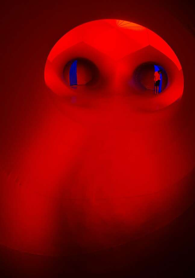 "A visitor explores the opening of the newest luminarium ""Exxopolis,"" designed by Architects of Air, in Los Angeles. A luminarium is a walk-in sculpture that combines light and color to create a sense of wonder. Photo: Joe Klamar, AFP/Getty Images"