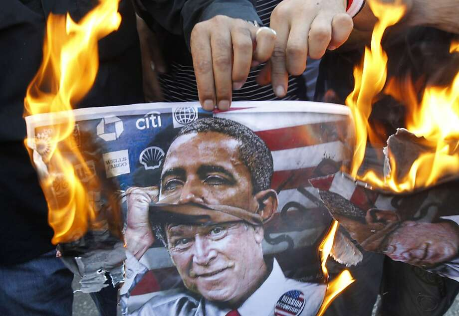Your mission, should you choose to accept it, is to ...A poster burned during a pro-Syrian regime rally outside the U.S. embassy in Beirut depicts former   president George W. Bush pulling off an Obama mask. Photo: Anwar Amro, AFP/Getty Images