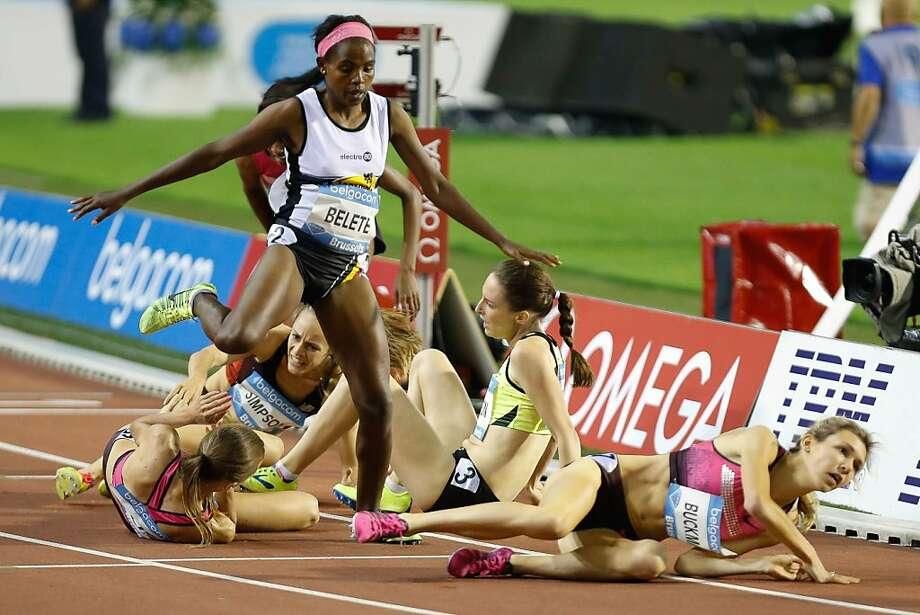 Pardon me, coming through:Belgium's Almensh Belete avoids a pileup during the women's 1500M race at the Memorial Van Damme meet in the Brussels Diamond League. Photo: Bruno Fahy, AFP/Getty Images
