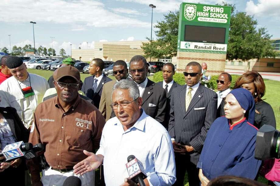 Samuel Rodriguez, center, and Reginald Gordon, left, with Operation Outreach OG-1, two of the community leaders to speak during a media conference held outside Spring High School Sunday, Sept. 8, 2013, in Spring. Spring H.S. student Joshua Broussard, 17, was fatally stabbed and three others injured at the school Wednesday, Sept. 3, 2013.  Luis Alonzo Alfaro, 17, has been charged with murder. Photo: Melissa Phillip, Houston Chronicle / © 2013  Houston Chronicle