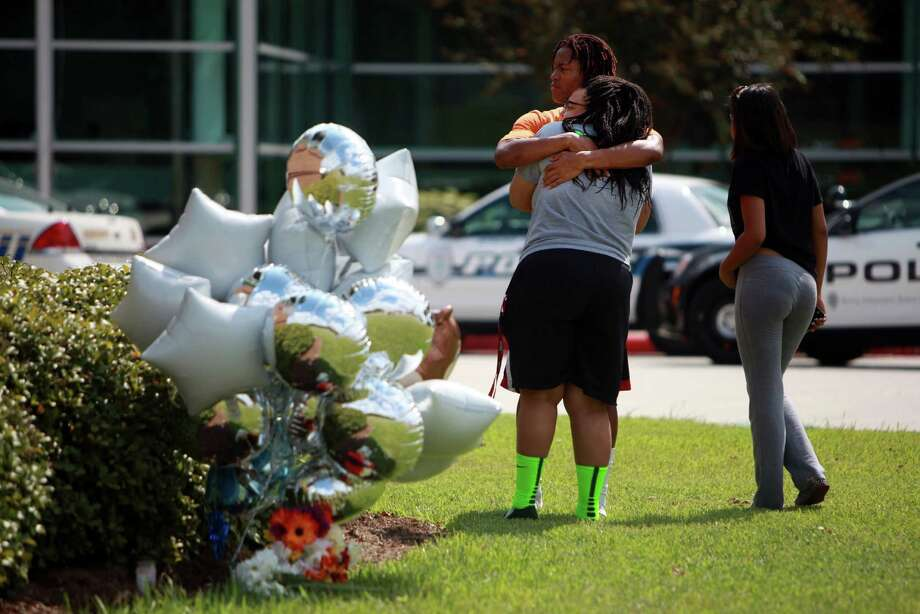 Braylon Alexander embraces an unidentified student near a memorial for Joshua Broussard outside of Spring High School on Friday, Sept. 6, 2013, in Spring. Photo: Mayra Beltran, Houston Chronicle / © 2013 Houston Chronicle