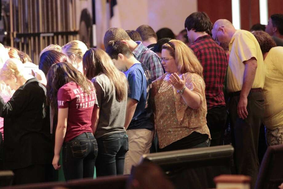 Spring High School students and parishioners participate in a prayer vigil in the wake of a stabbing death at Spring High school Wednesday morning. Photo: Billy Smith II, Chronicle / © 2013 Houston Chronicle