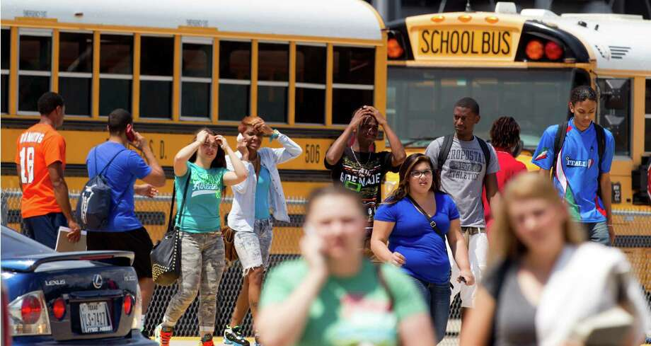 Students walk to busses outside Spring High School as they are released to go home following a stabbing incident the school Wednesday, Sept. 4, 2013, in Spring. A student was stabbed to death and three others are injured after a fight at suburban school. Photo: Brett Coomer, Houston Chronicle / © 2013 Houston Chronicle