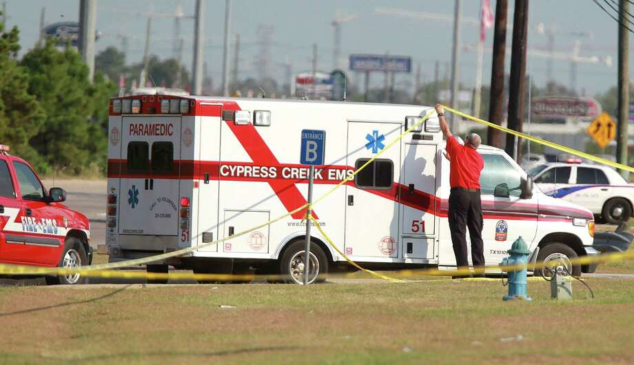 Ambulance enters Spring High School parking as Harris County Sheriffs investigate the fatal stabbing of a 17 year-old student on Wednesday, Sept. 4, 2013, in Spring. Photo: Mayra Beltran, Houston Chronicle / © 2013 Houston Chronicle