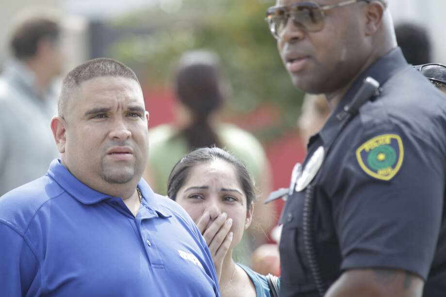 Angel and Maria Marrero,parent of a junior boy, try to get answers outside Spring High School where a student was fatally stabbed and three others injured Wednesday, Sept. 3, 2013. (Melissa Phillip/ Houston Chronicle)
